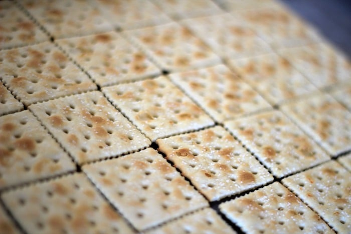 Now, for the step-by-step tutorial. First, lay saltines out flat on a ...