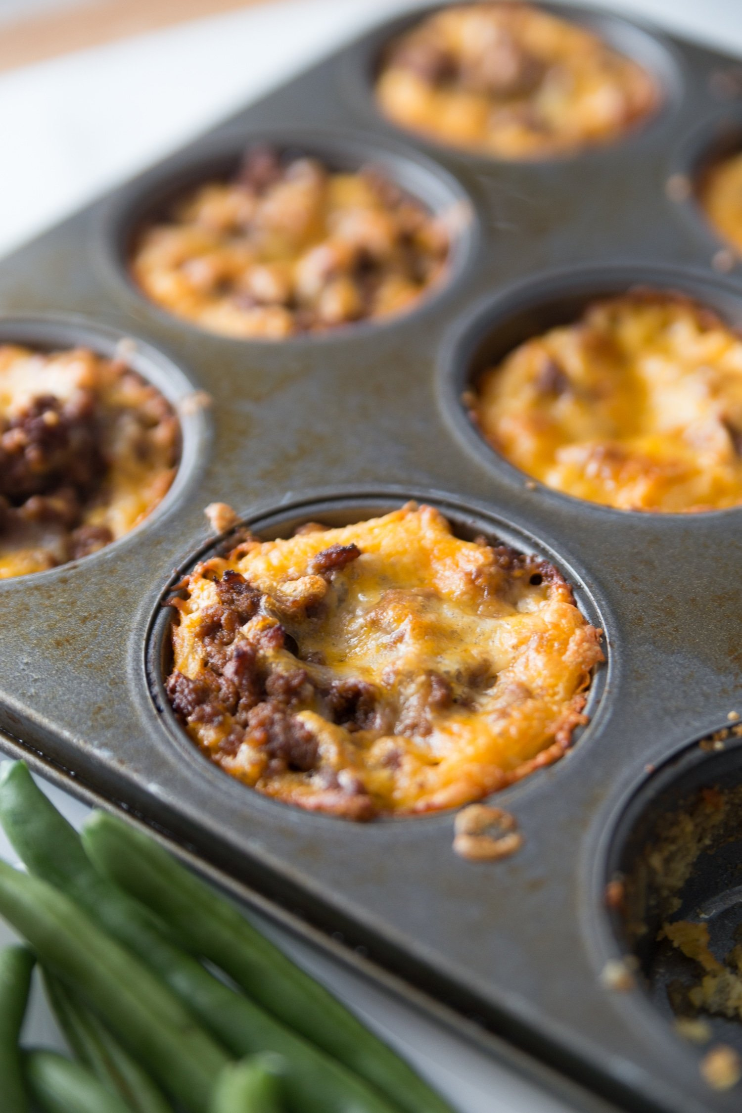 Farmhouse BBQ Low Carb Muffin Cups are loaded with tangy sugar-free low carb bbq sauce and cheesy goodness for an easy and delicious keto dinner idea. #keto #lowcarb
