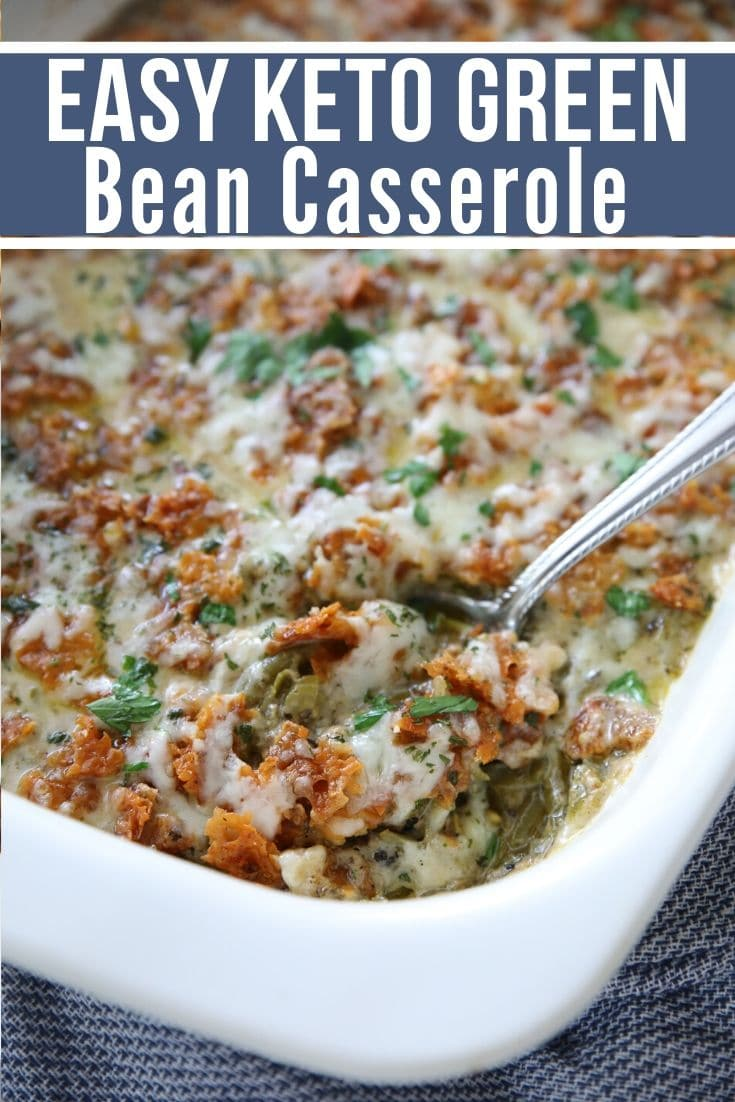 keto green bean casserole in a white casserole dish with a spoon