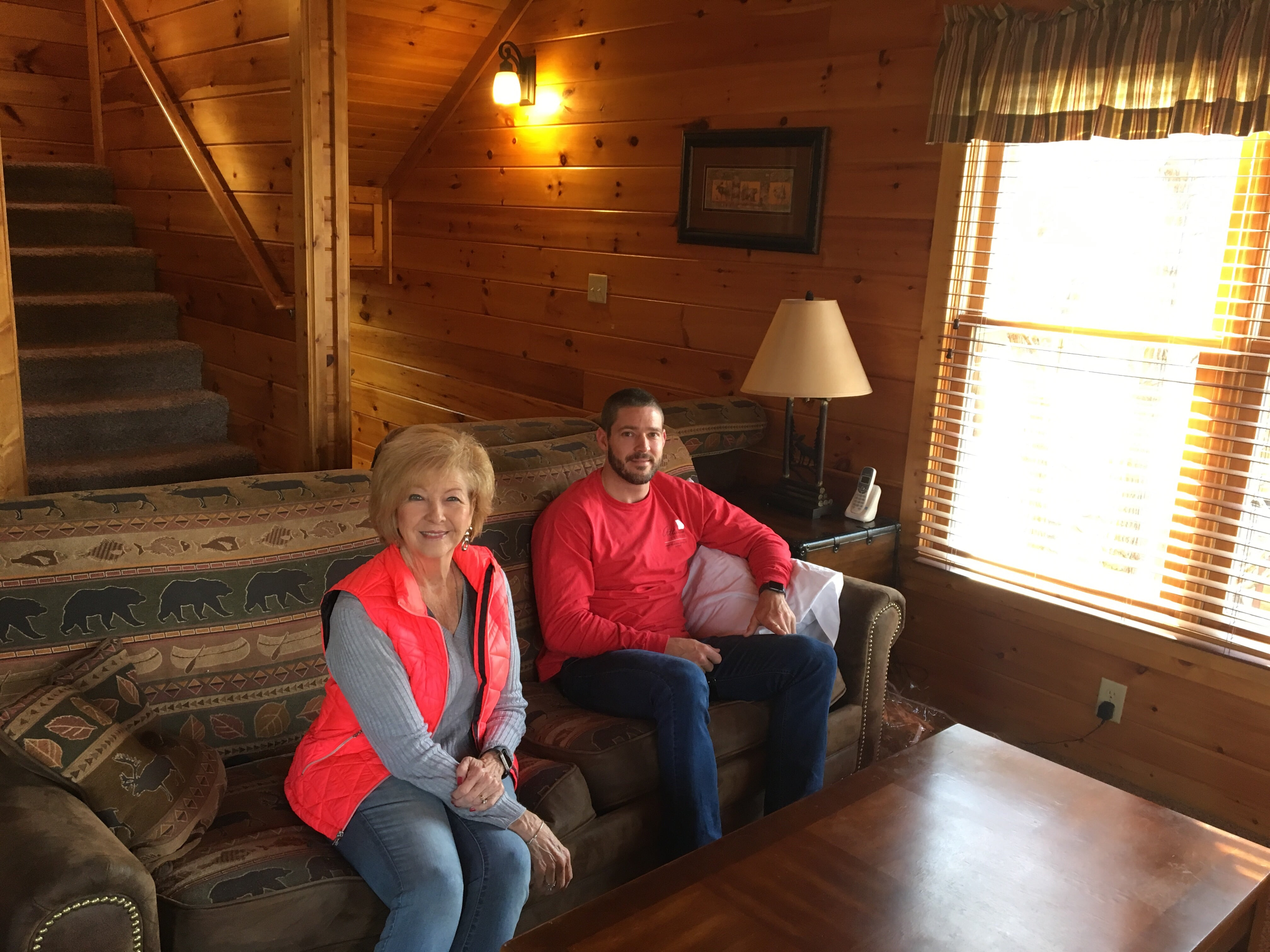 Grandmother and son on couch in a cabin