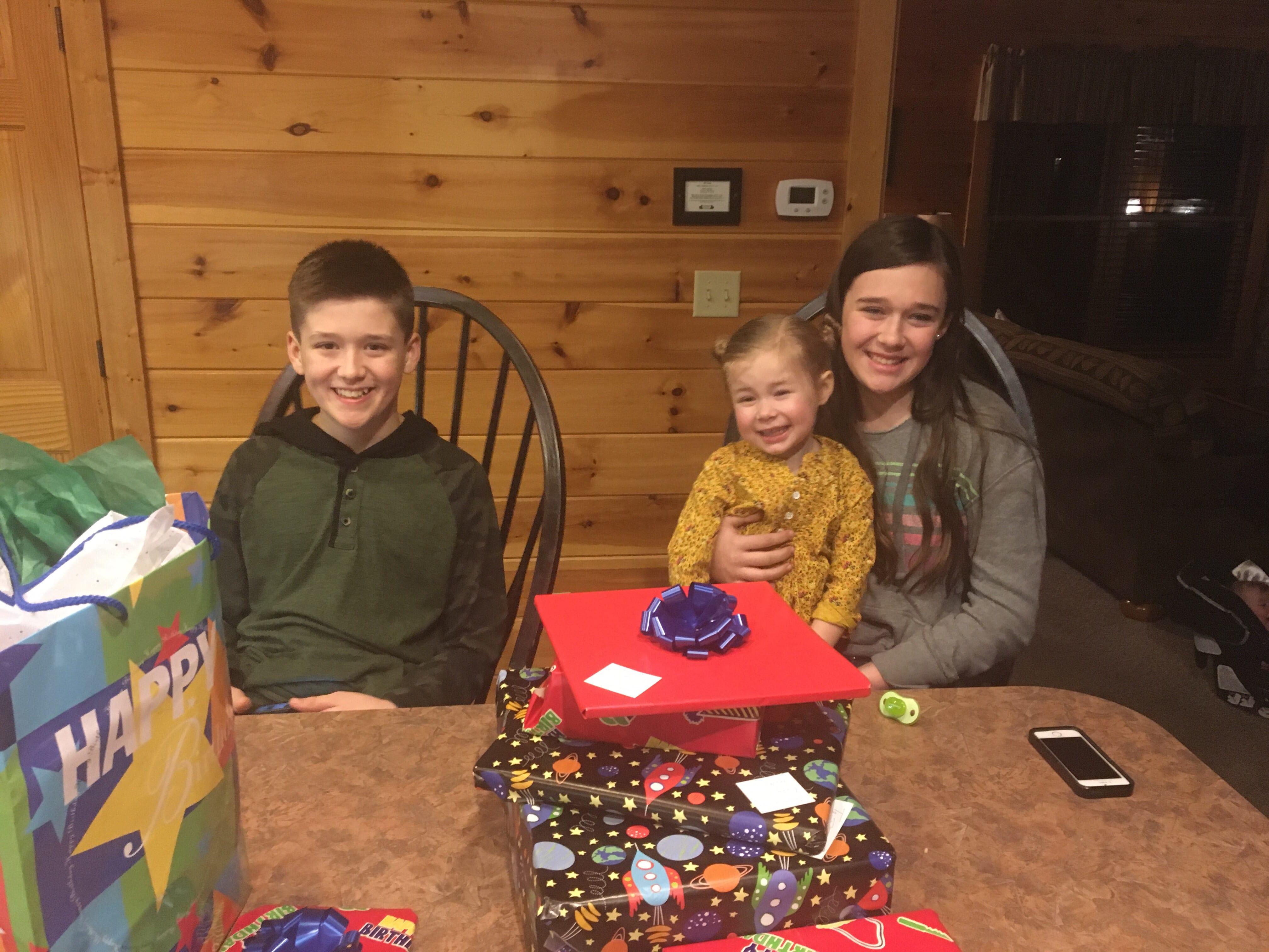 birthday celebration for 3 kids in a cabin