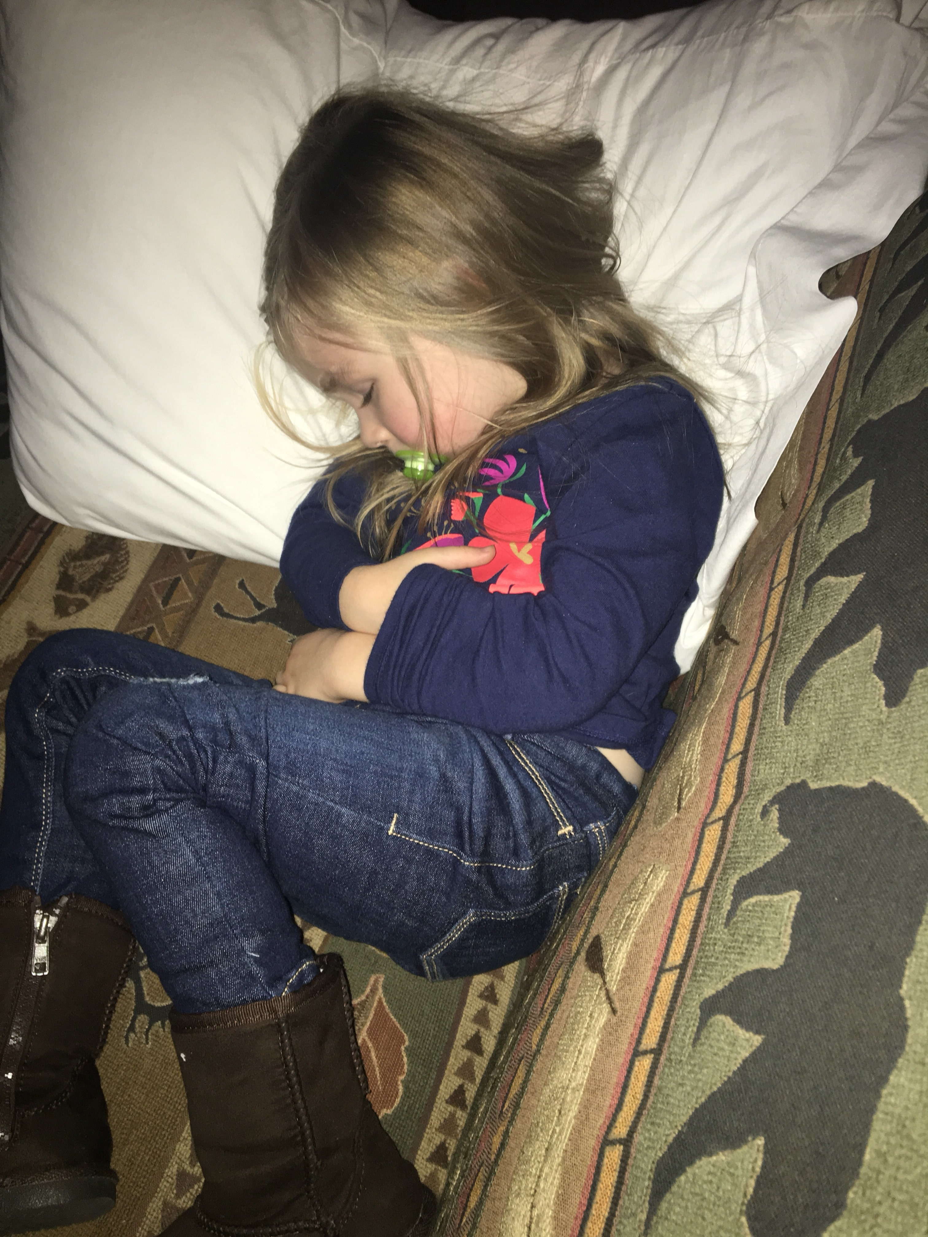 little girl sleeping on couch