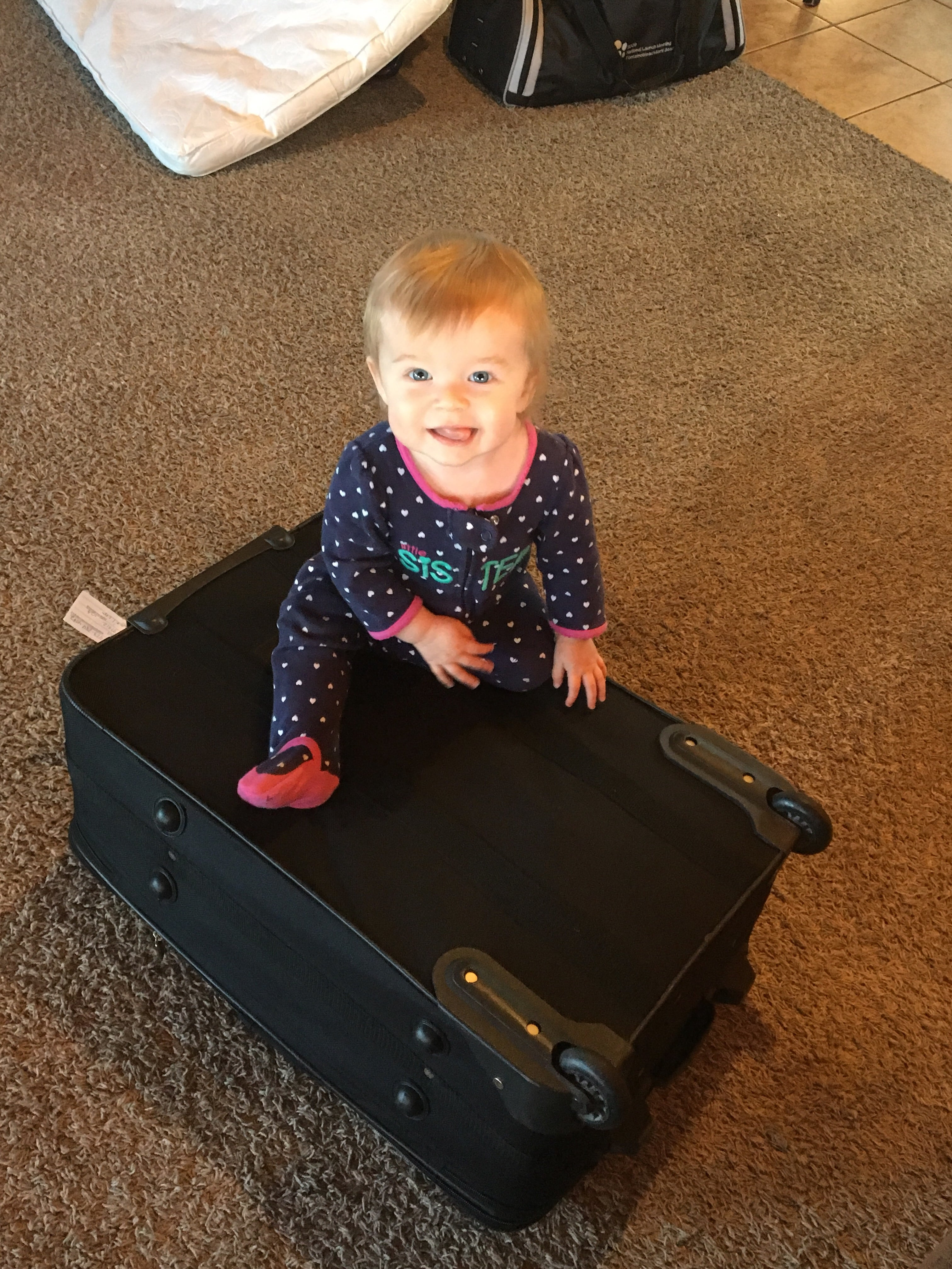 baby on a suitcase
