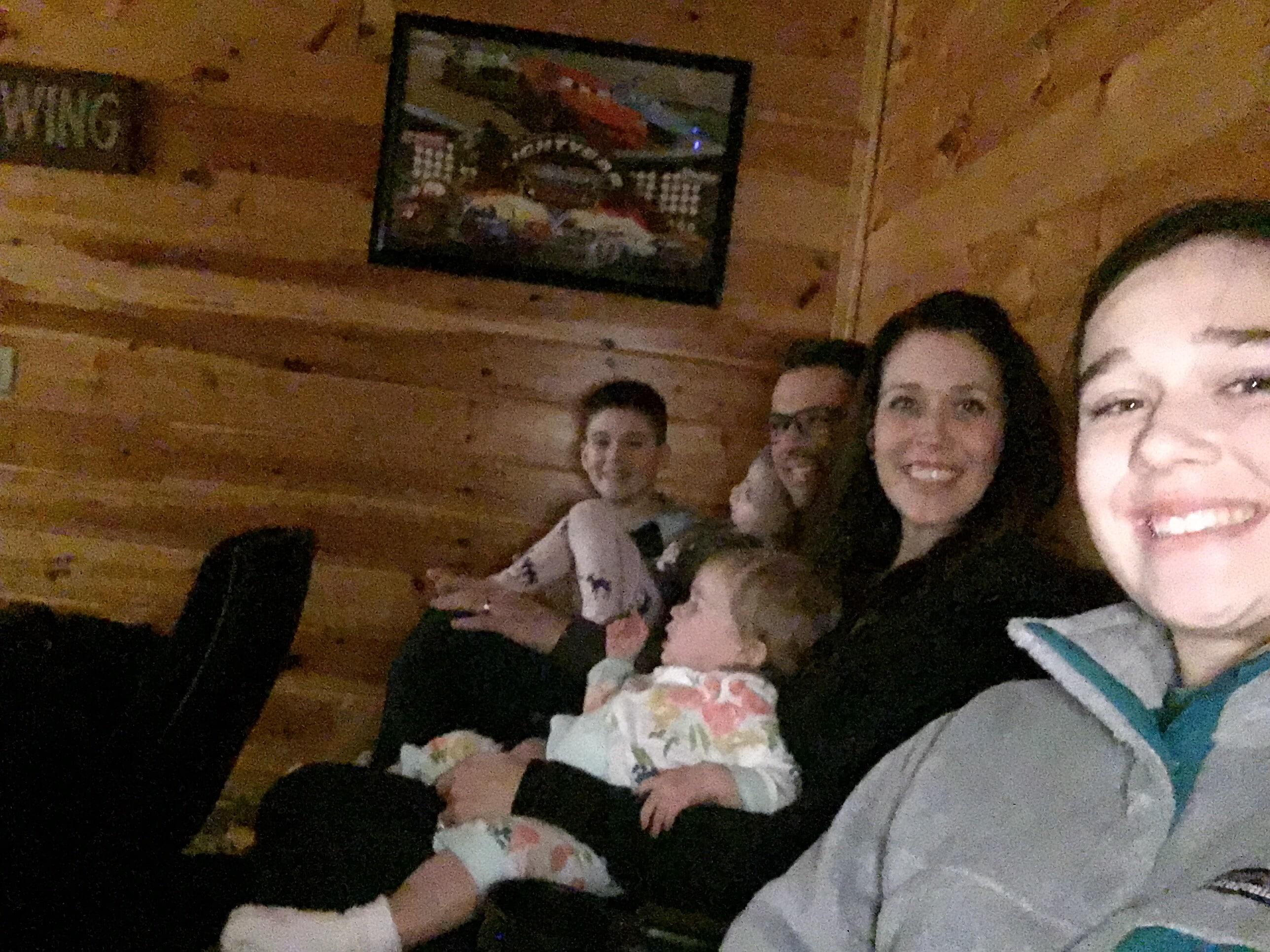 family in media room a cabin in Gatlinburg