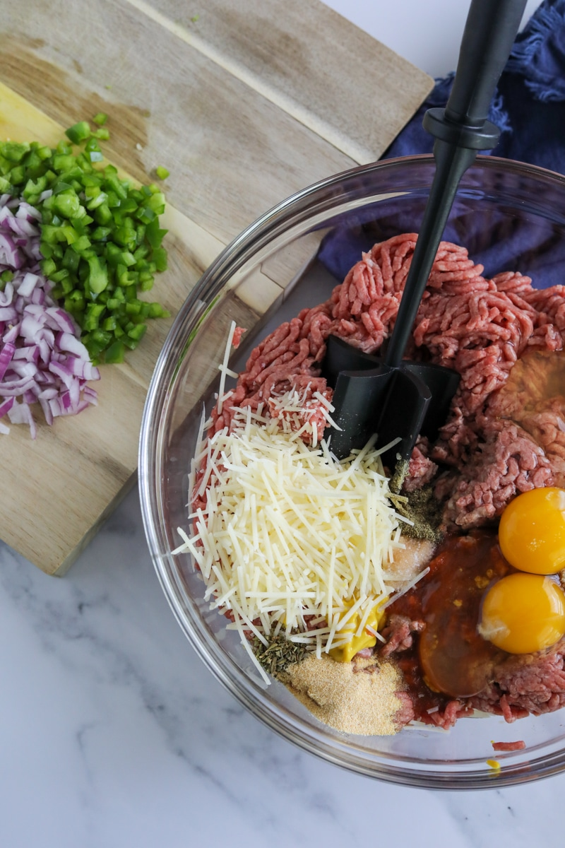 ingredients for meatloaf in a clear bowl