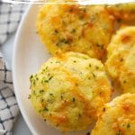 keto cheddar bay garlic biscuits on a white plate