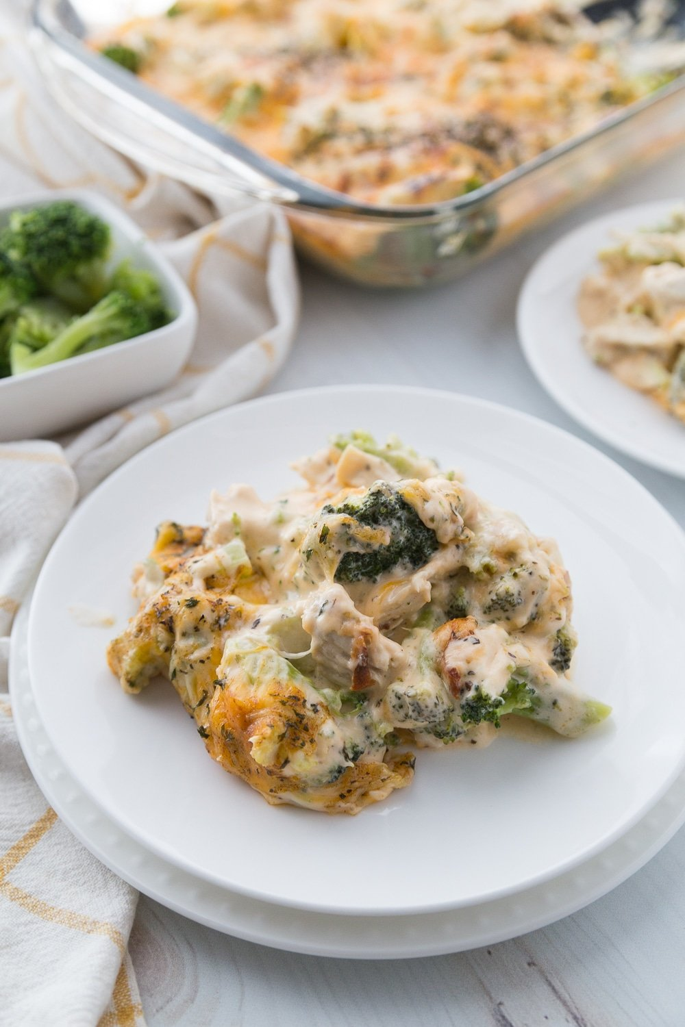 This simple Low Carb Chicken Casserole is packed full of delicious chicken, broccoli, and cheese. The entire family will enjoy. #keto #lowcarb