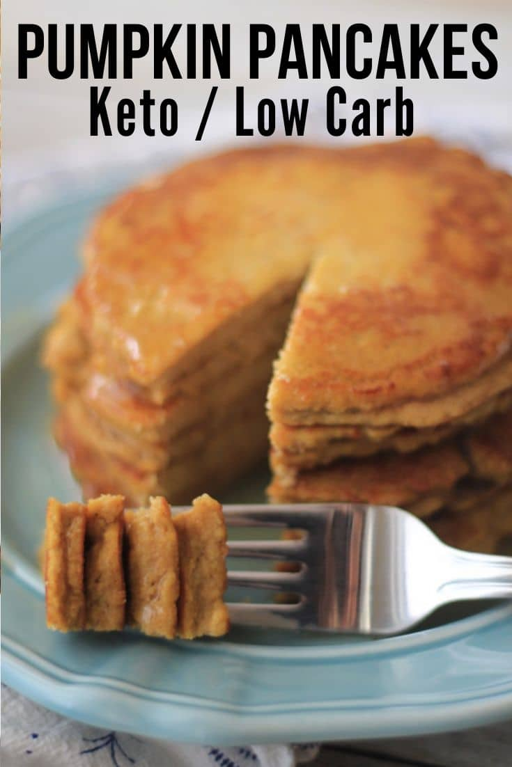 fluffy keto pumpkin pancakes plated with a bite on fork on a blue plate