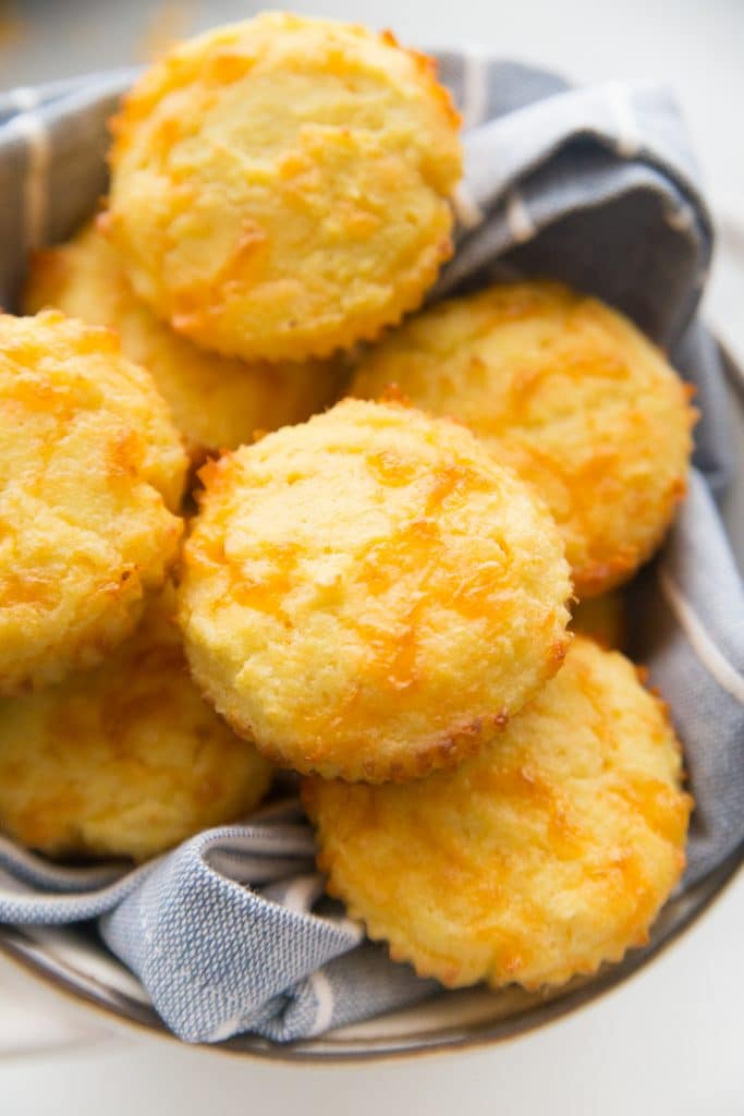 low carb biscuits in a basket with a kitchen towel under them
