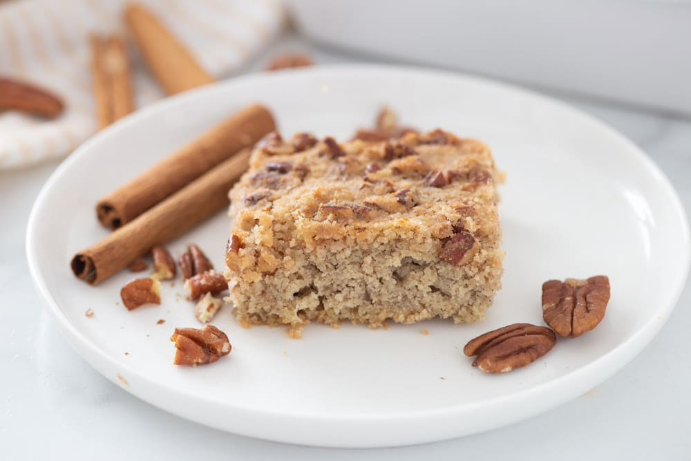keto coffee cake recipe plated on a white plate with pecans on the plate