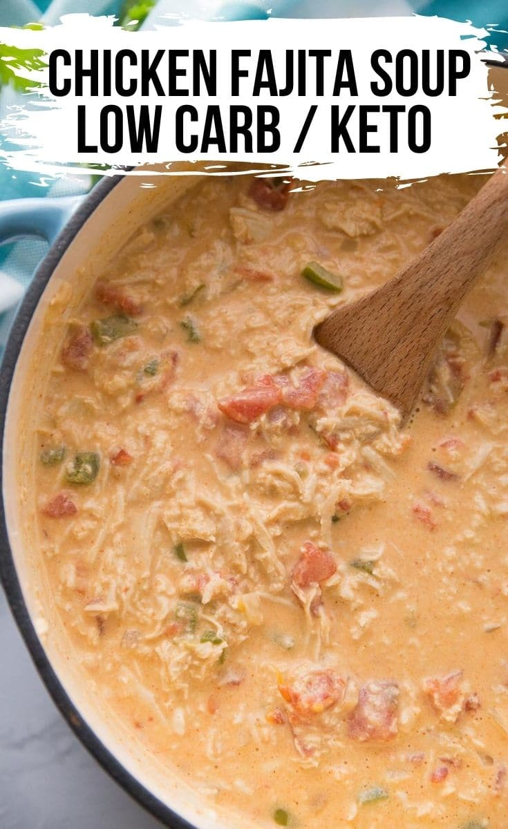 Pot of chicken fajita soup with a wooden spoon in the pot
