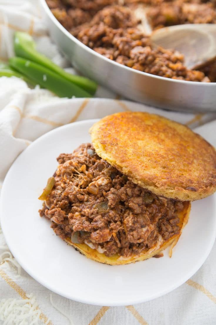 keto sloppy Joe on 90 second bread with a skillet behind it