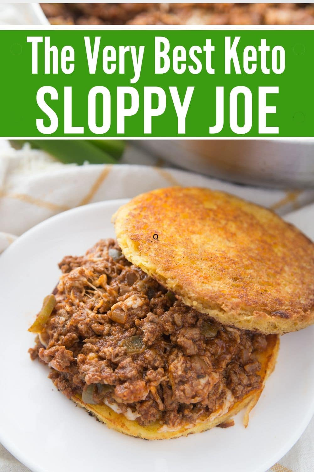 Keto Sloppy Joe on 90-Second Bread plated with a skillet in the background