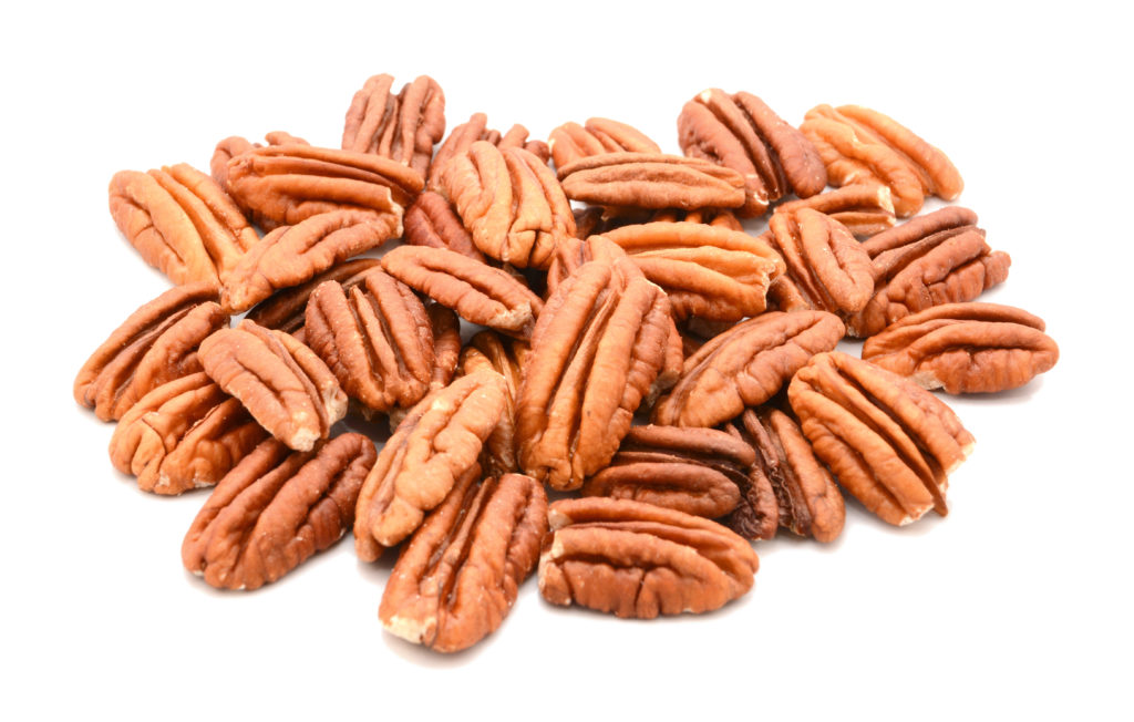 Whole pecan nuts on white background for meal prep on keto