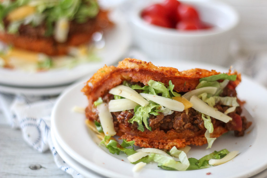 Taco Chaffle recipe with ground beef, lettuce, and cheese