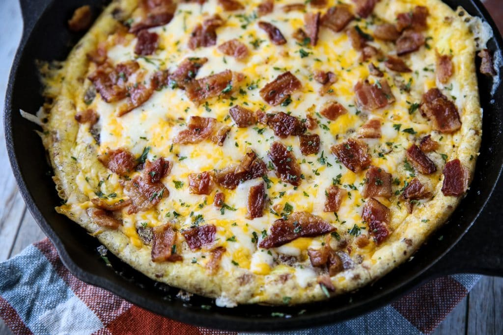 bacon eggs and cheese keto frittata baked in a cast iron skillet