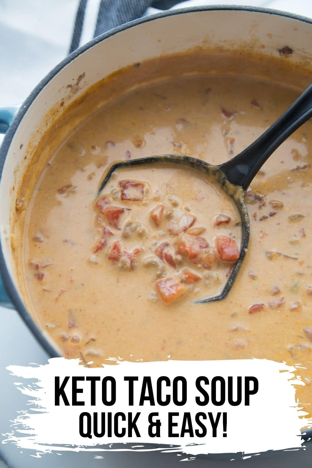 bowl of easy Queso Taco Soup in a bowl topped with cilantro and grated cheese