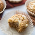 low carb pumpkin cream cheese muffin with a bite taken out of it