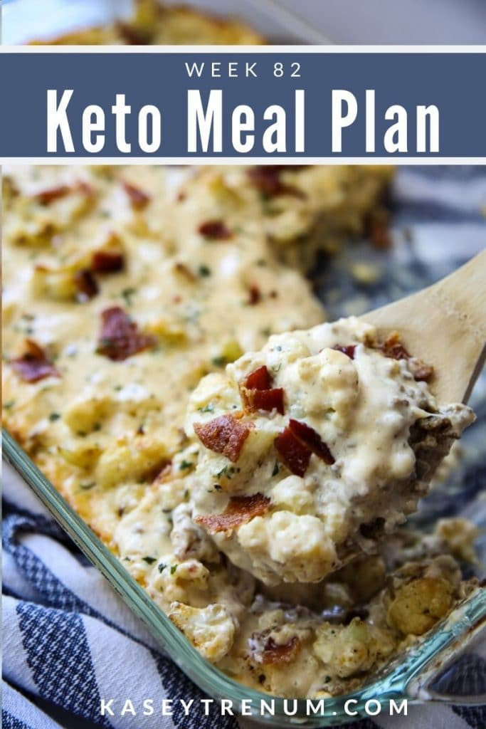 Keto Cauliflower Casserole with hamburger meat in a clear dish with wooden spoon
