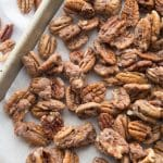 keto candied pecans on a cookie sheet