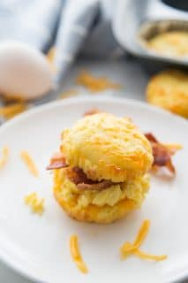 A picture of Keto Low Carb Biscuits on white dish with an egg in the background