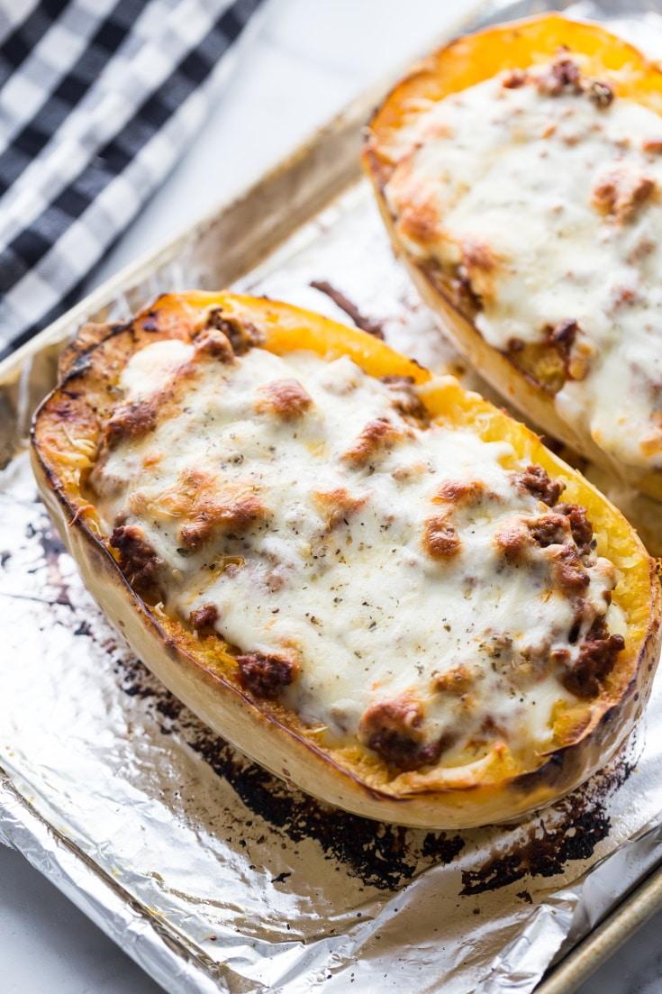Keto Spaghetti Squash Lasagna with mozzarella cheese browned on top on a baking sheet