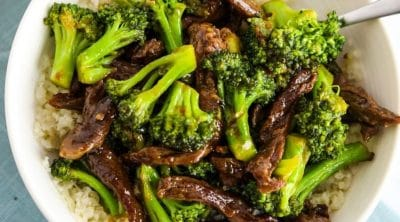 beef & broccoli stir fry in white bowl
