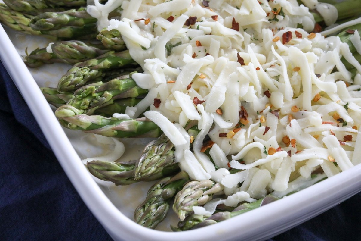 Asparagus topped with the creamy cheese sauce and mozzarella cheese.