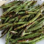 A picture of Keto Air Fried Roasted Green Beans on a white dish