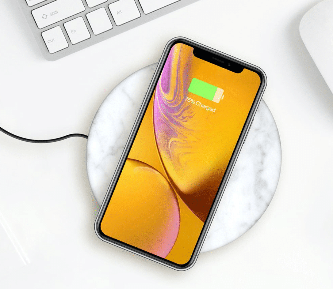 iphone charger with a keyboard in the background