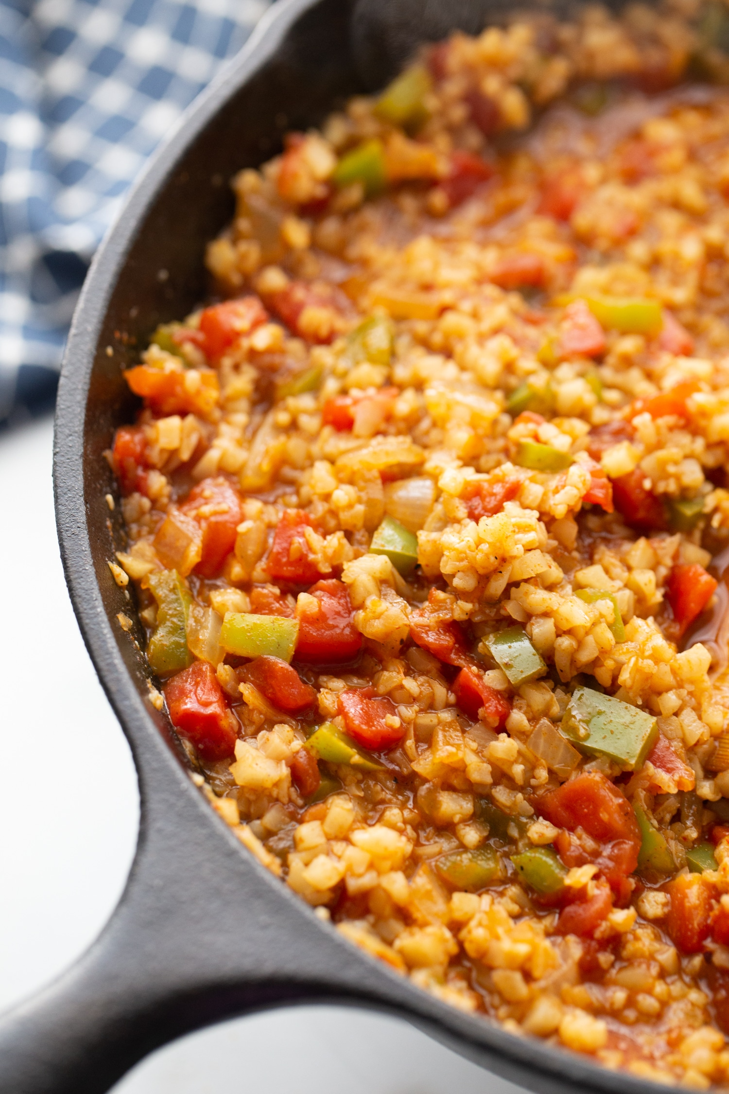 Taco seasoning with riced cauliflower in a skillet