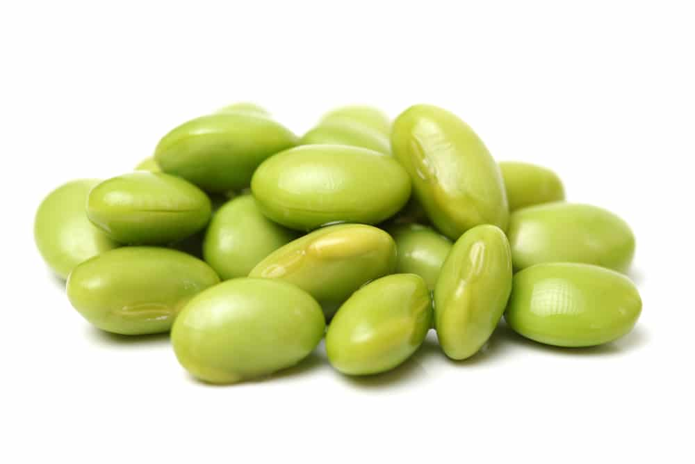 edamame beans on a white surface
