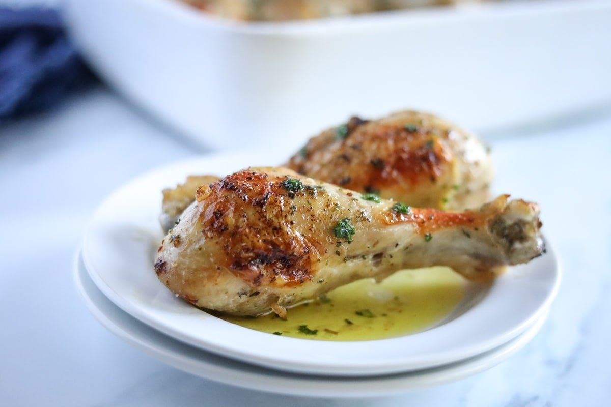 baked chicken legs plated on a white plate