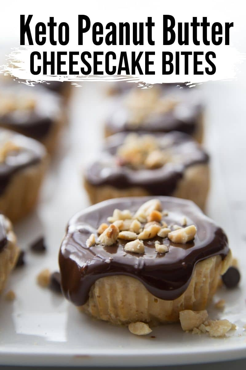 mini cheesecakes covered in chocolate sauce with peanuts on a white plate