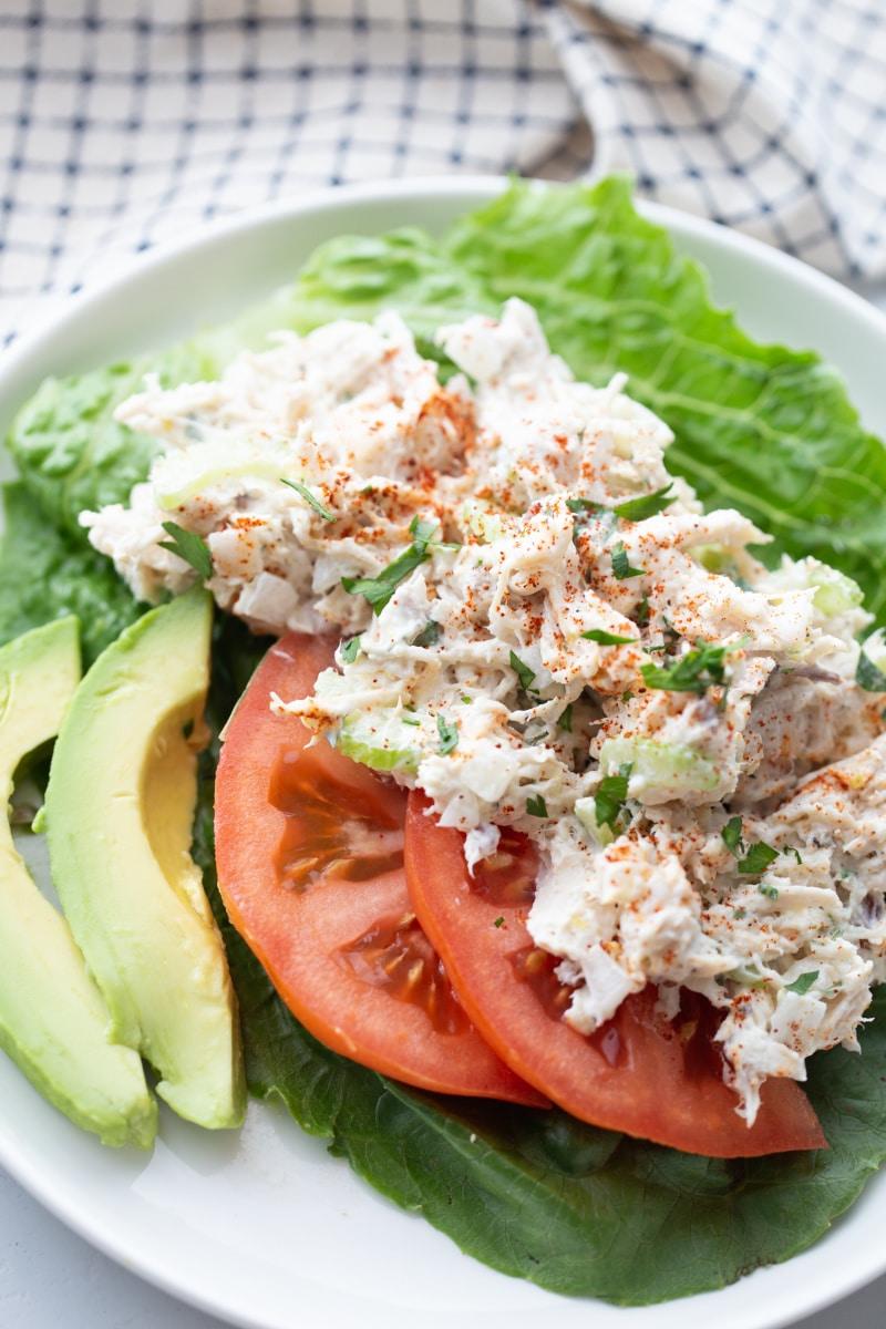 keto chicken salad wraps with sliced tomato and avocado