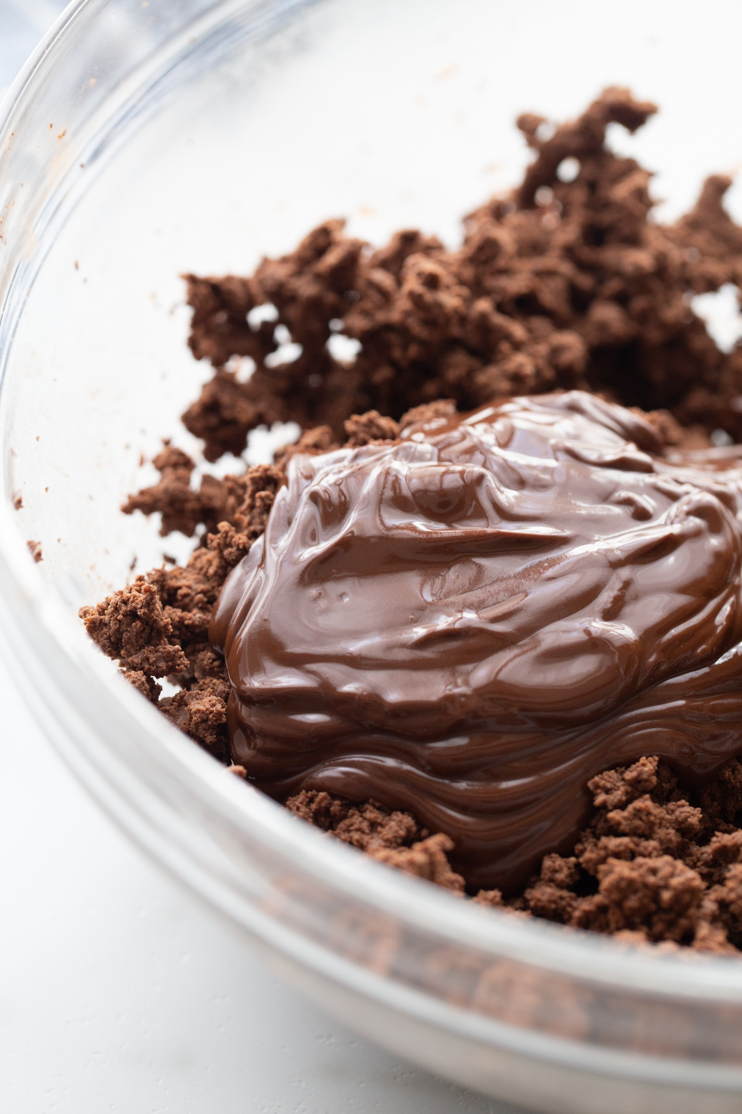 keto chocolate melted in a bowl with pie filling