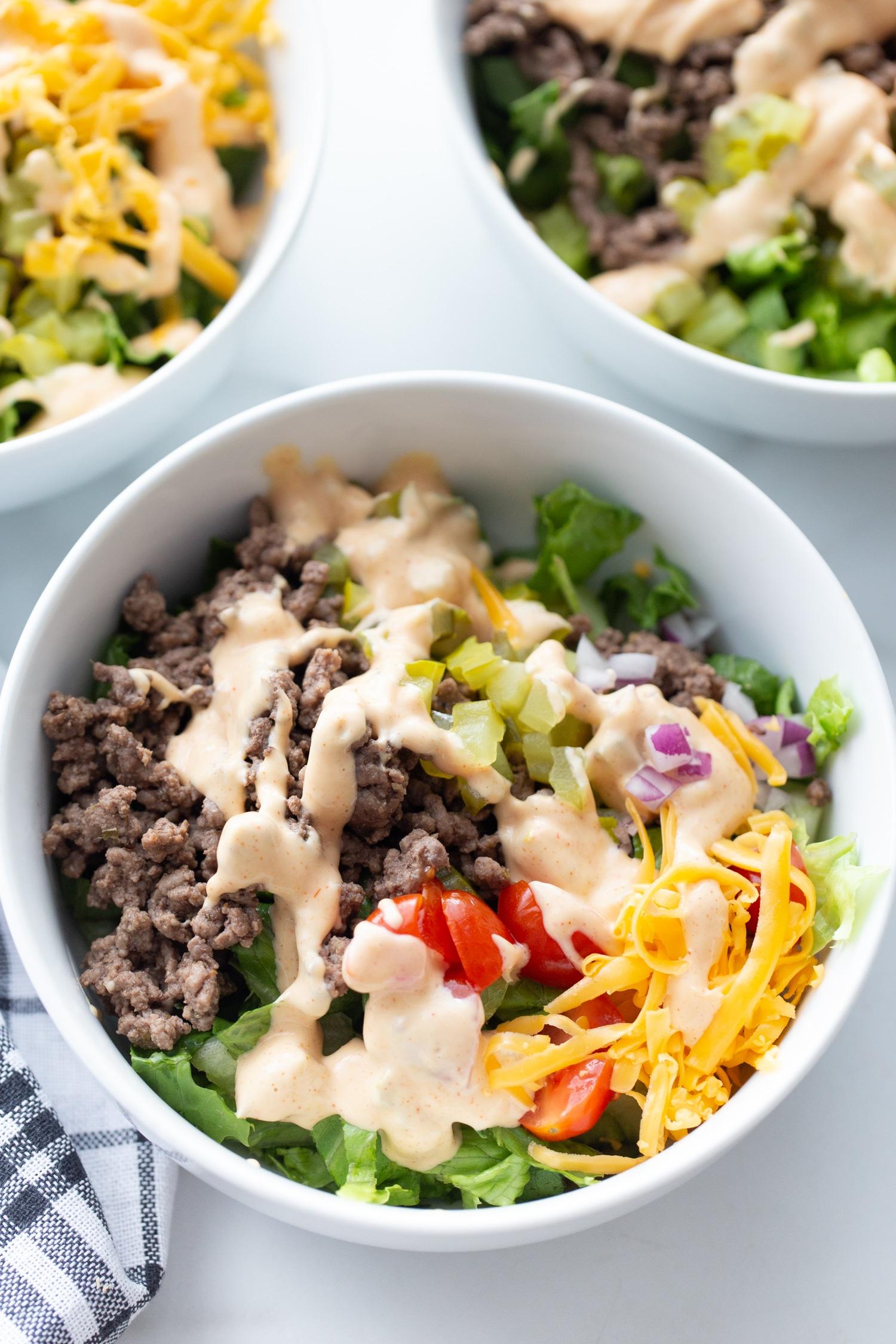 keto big mac salad bowl with big mac dressing on top