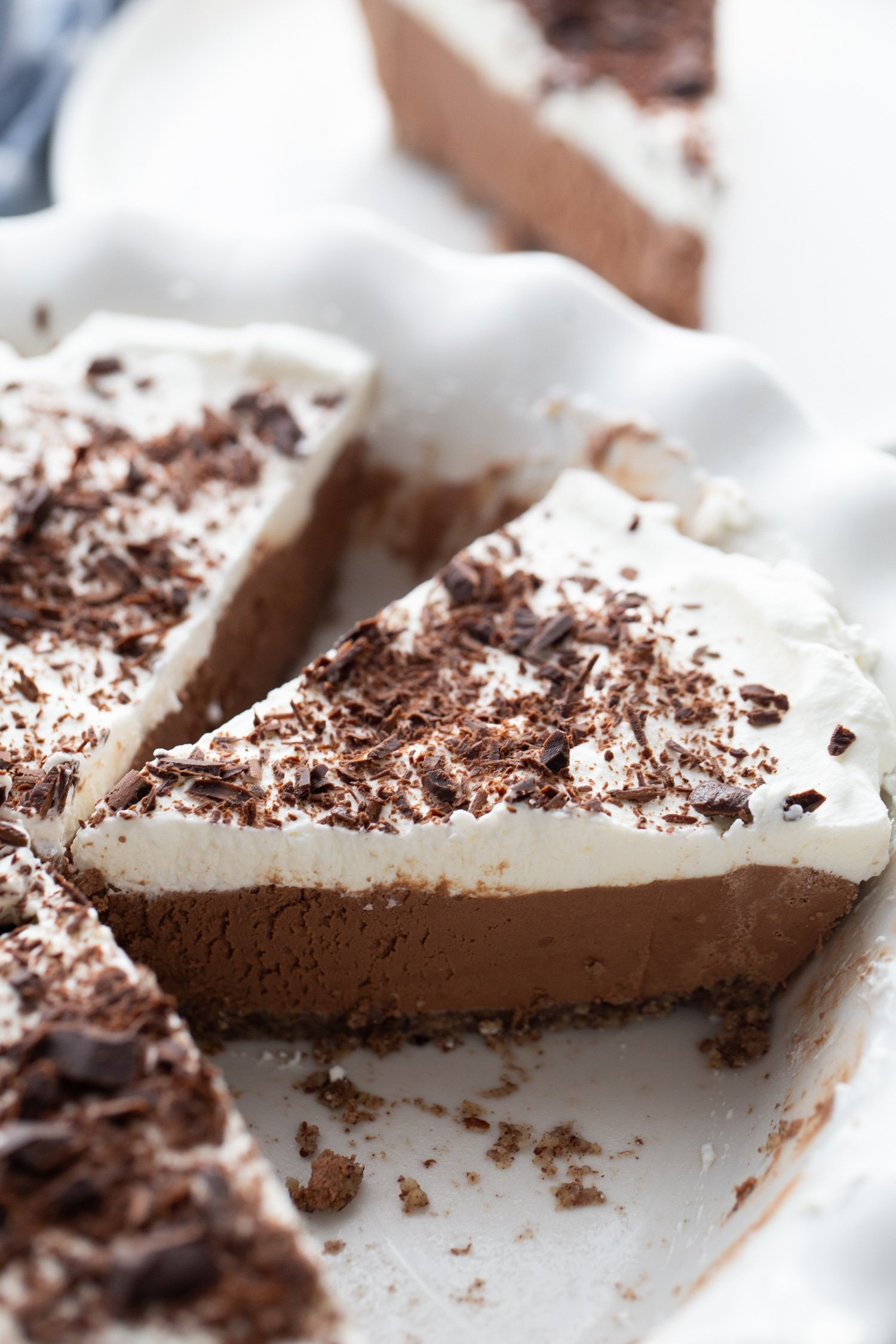 keto chocolate mousse slice with chocolate shavings on top