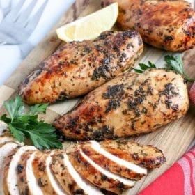 air fryer chicken breasts on a cutting board