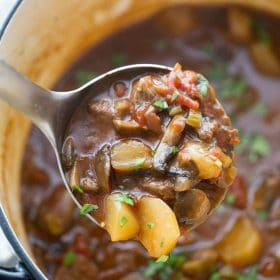 healthy slow cooker keto beef stew in a ladel