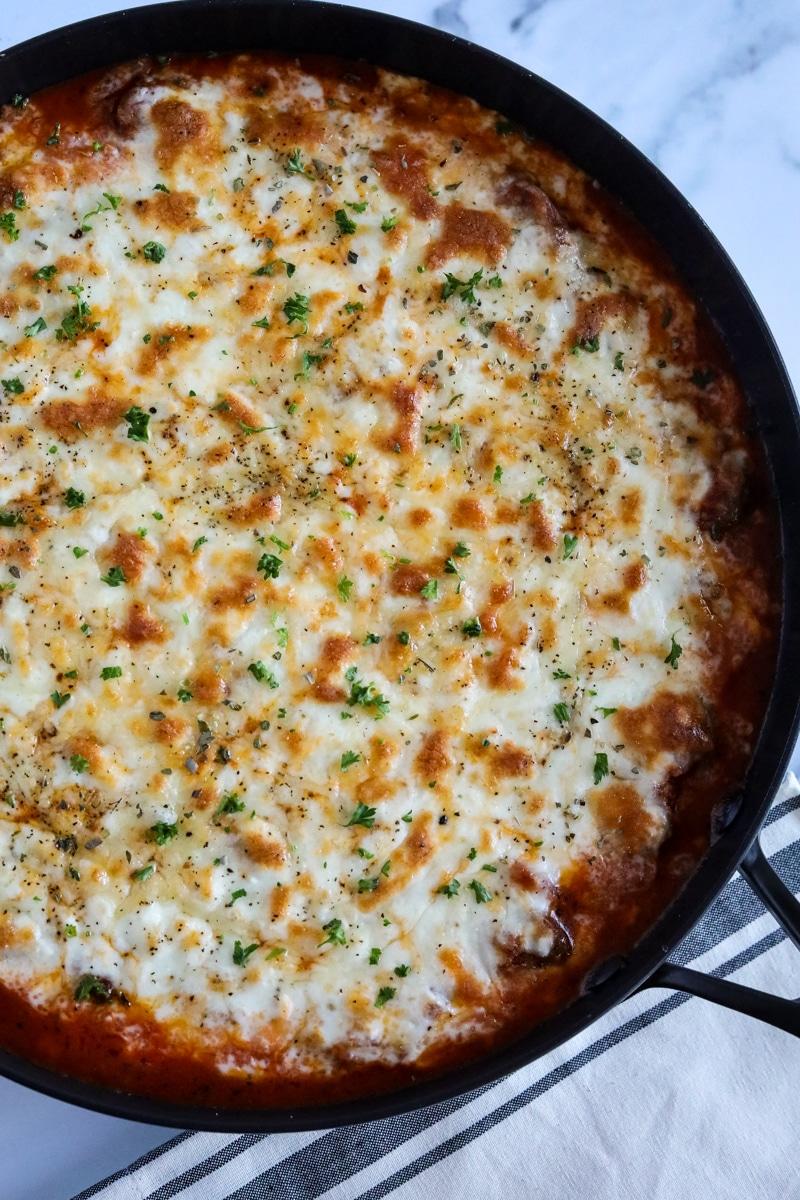 mozzarella cheese melted over top of marinara sauce