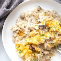 chicken cauliflower rice cheese and mushrooms on a white plate