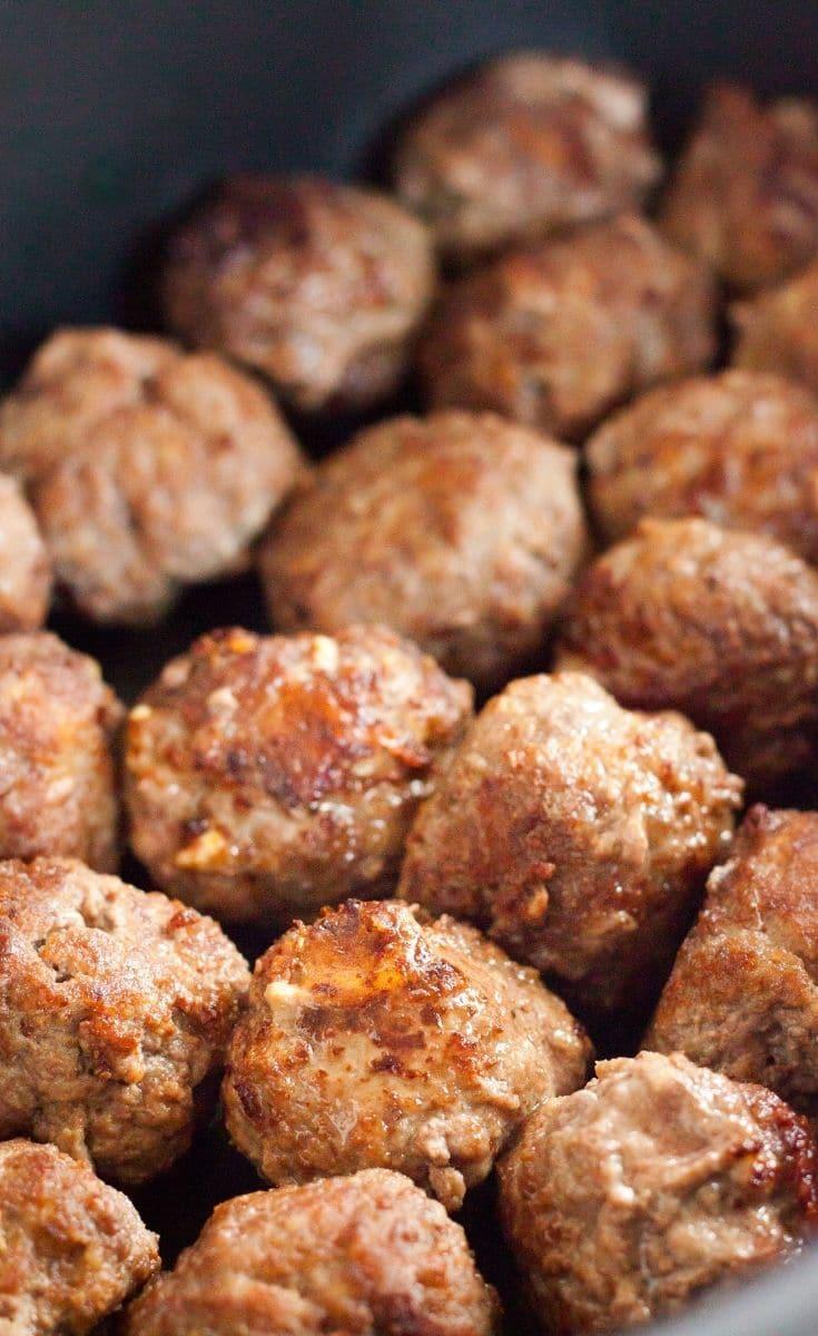 Unbaked meatballs in pan