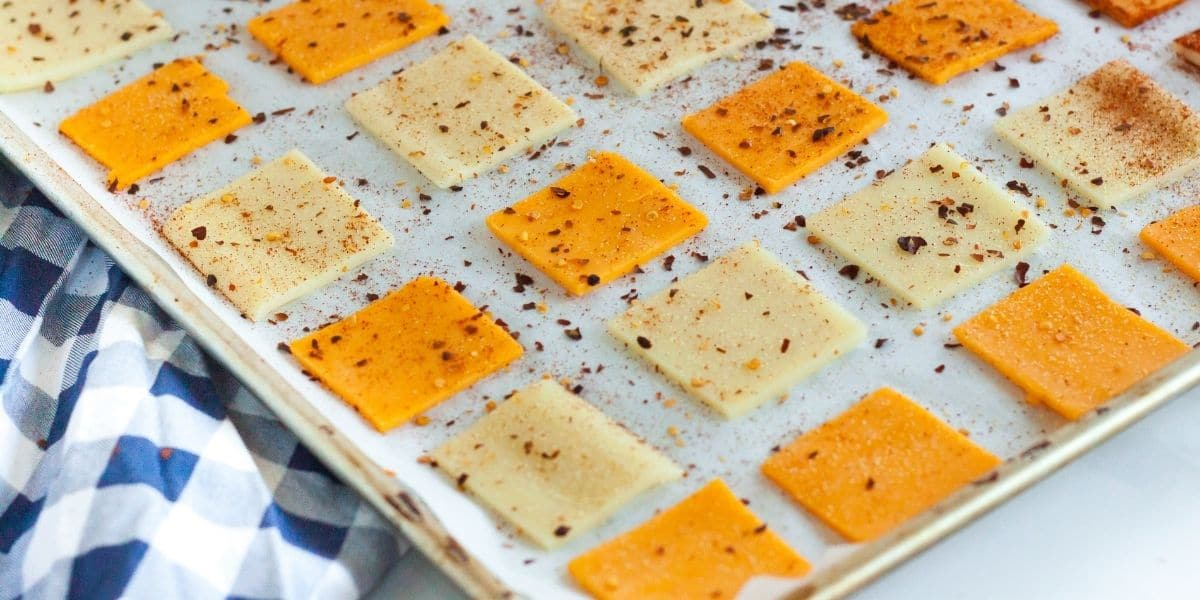 Spices sprinkled on cheese slices