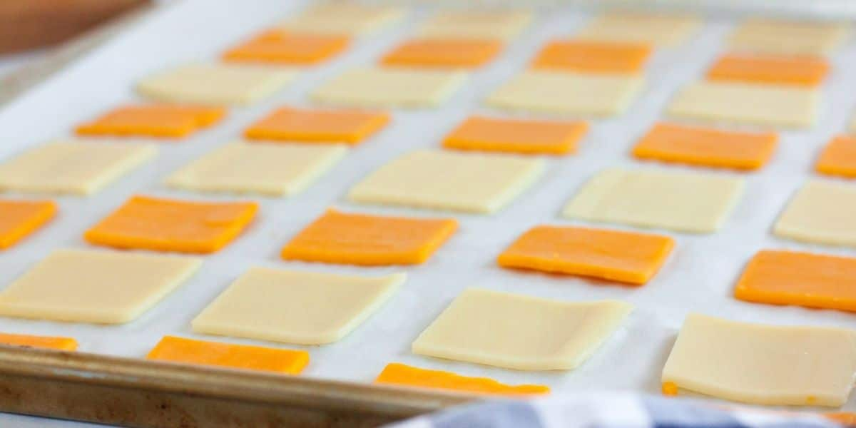cheese slices laying on parchment paper