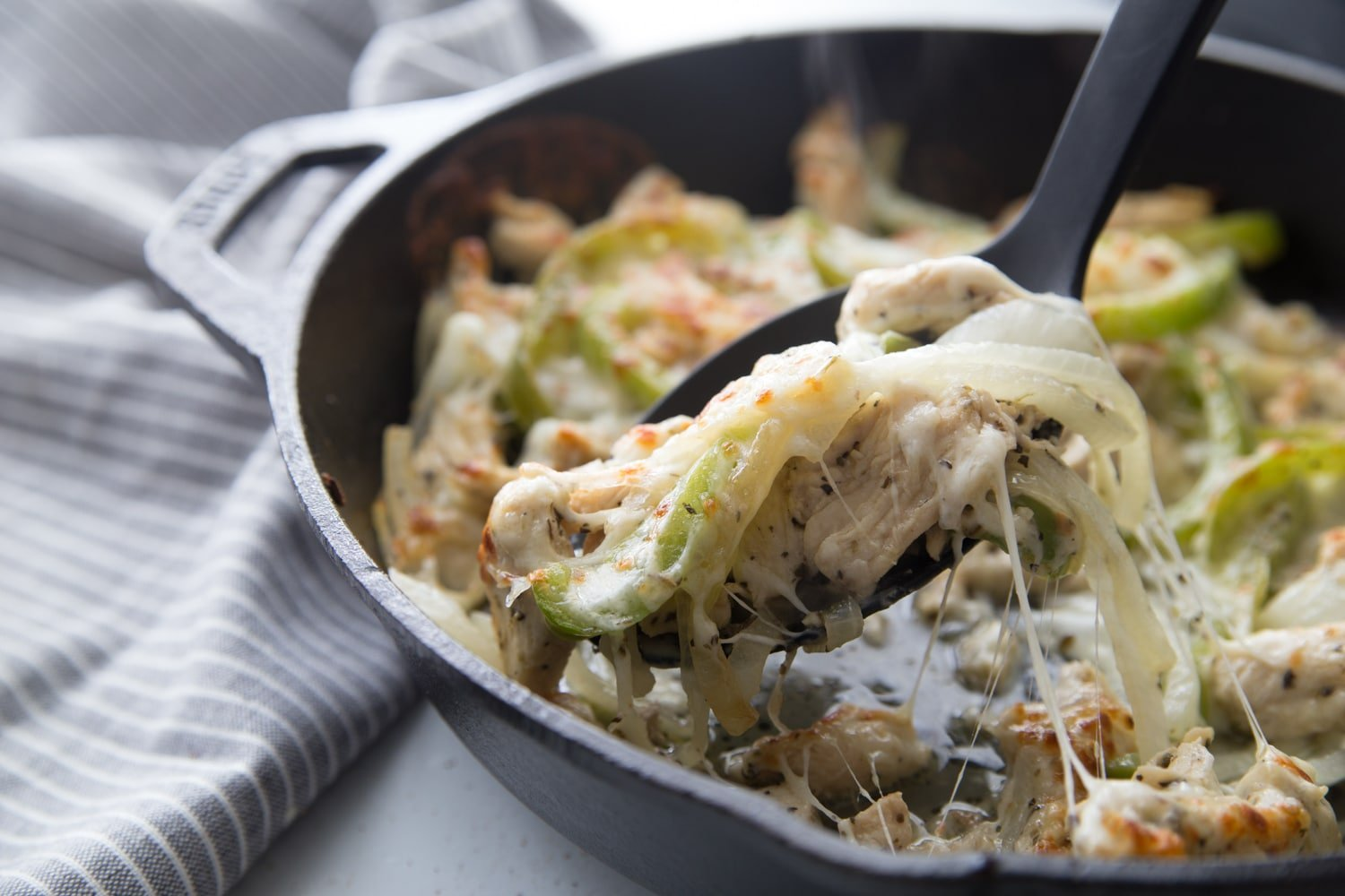 ready to eat philly chicken cheesesteak in cast iron pan