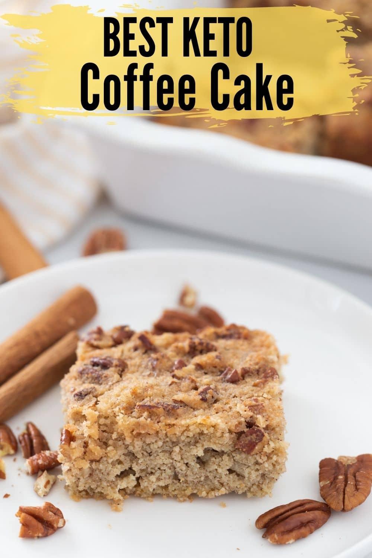 keto coffee cake on a white plate with cinnamon sticks