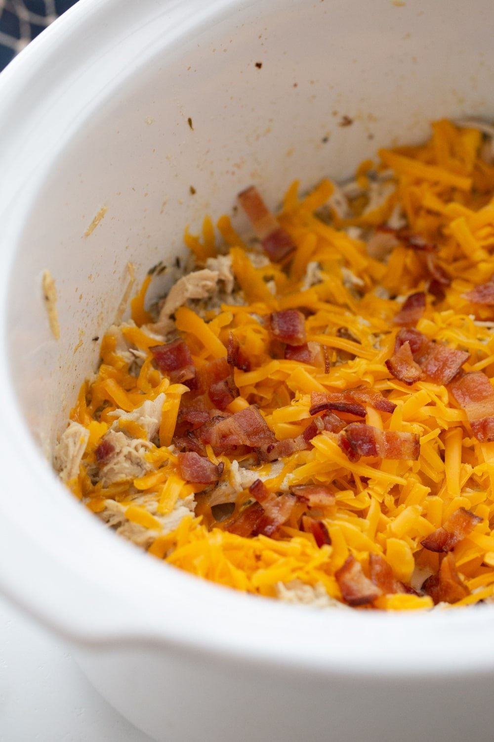 chese and bacon covering the keto creamy chicken