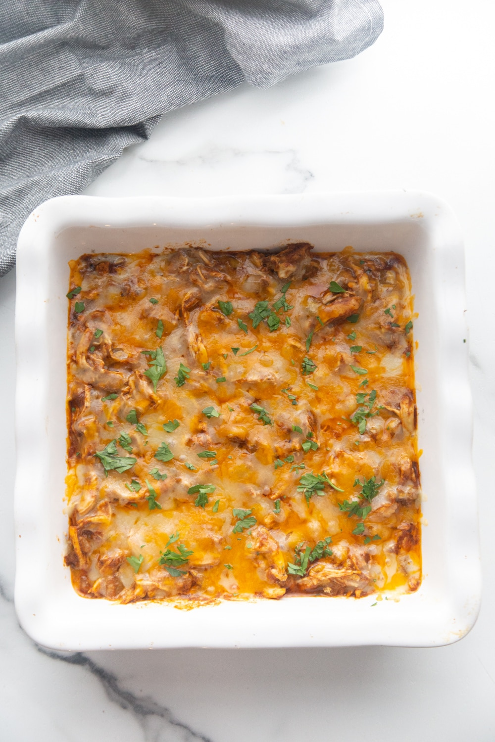finished enchilada casserole in a pan